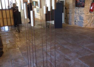 sculpture bois/métal bougeant au grès des éléments